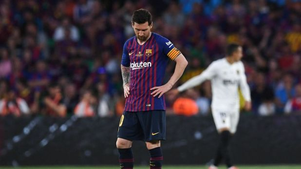 A dejected Lionel Messi looks on after the final whistle