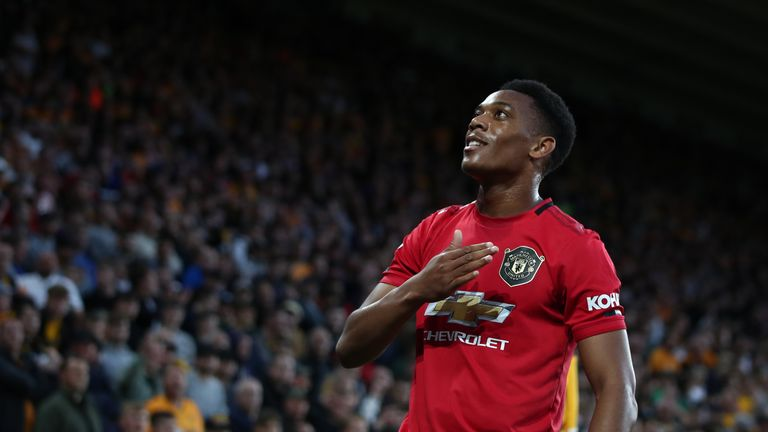 Anthony Martial celebrates opening the scoring