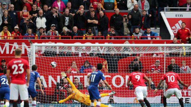 Marcus Rashford puts United ahead during the opening-day match with Chelsea
