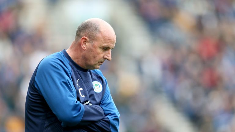 Paul Cook has left Wigan after more than three years in charge