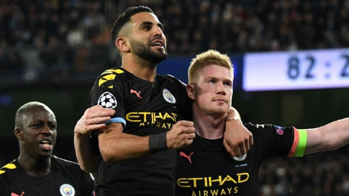 Man City's Kevin De Bruyne celebrates with team-mate Riyad Mahrez after scoring in the 2-1 Champions League win at Real Madrid in February