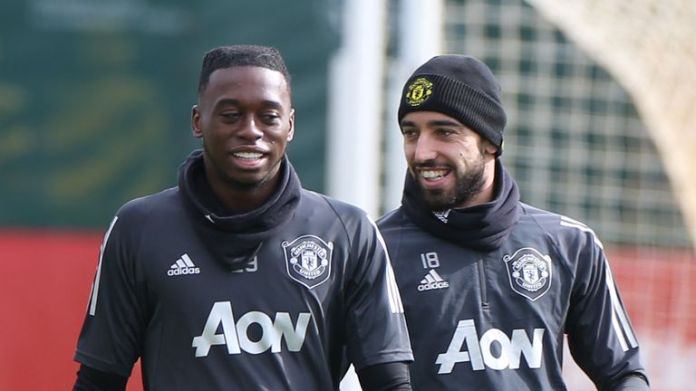 Aaron Wan-Bissaka and Bruno Fernandes of Manchester United in action during a first team training session