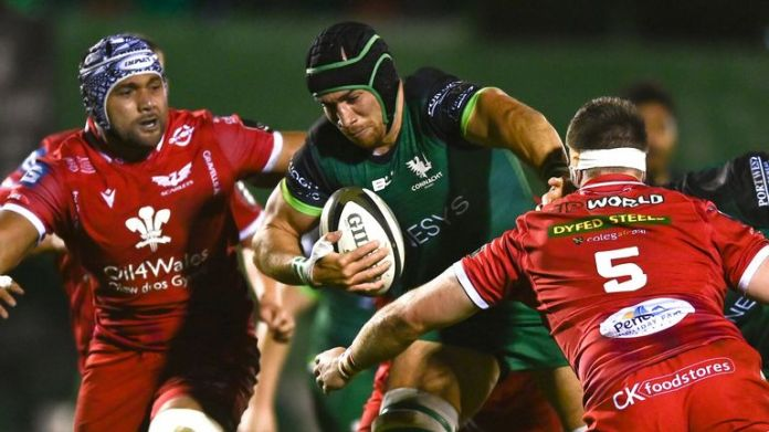 Connacht try-scorer Ultan Dillane takes on the Scarlets defence
