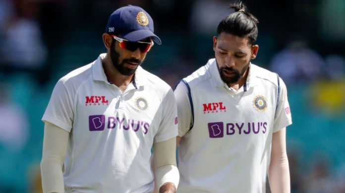 India bowlers Jasprit Bumrah (left) and Mohammed Siraj reported hearing racial slurs during the third Test against Australia