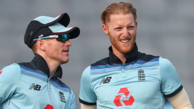 Stokes, right, celebrates with captain Eoin Morgan after dismissing India's Shikhar Dhawan in the first ODI