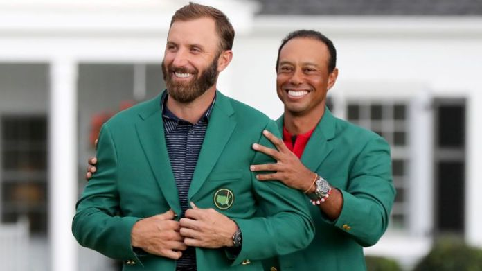Johnson was presented with his Green Jacket by Tiger Woods after winning in 2020