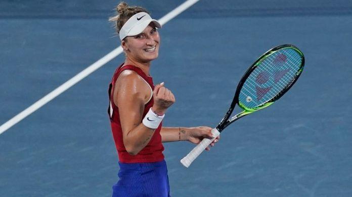 Marketa Vondrousova celebrates after defeating Elina Svitolina