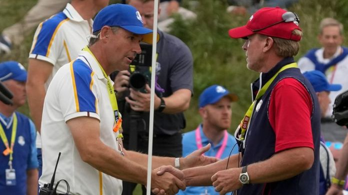 Steve Stricker is congratulated by Padraig Harrington after Team USA romped to victory