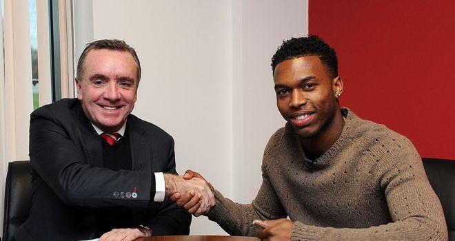 Deal done: Ian Ayre and Daniel Sturridge shake on it