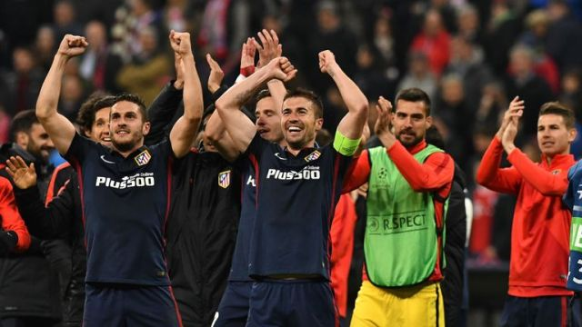 Atletico Madrid players celebrate qualifying for the final of the Champions League