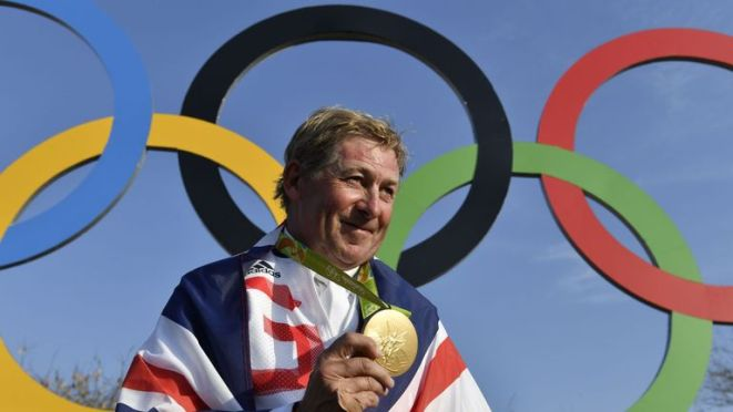 Britain's Nick Skelton celebrates with his gold medal