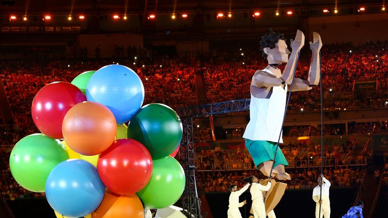 Performers entertain during the ceremony at Maracana Stadium