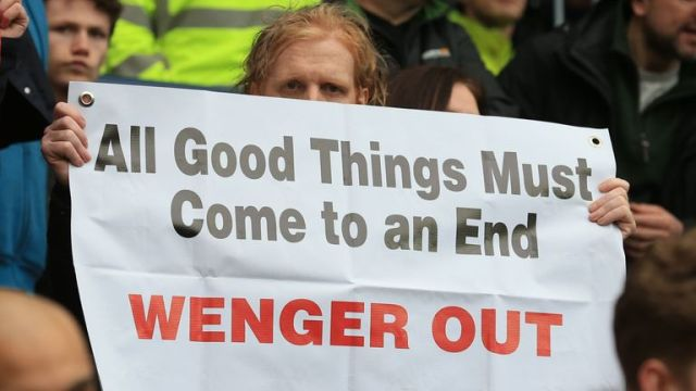 Arsenal fans hold up anti-Wenger signs after the match at West Brom