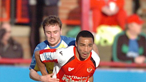 Wilson in action for Kettering Town in 2011 [Credit: Mike Capps / Kappa Sport]