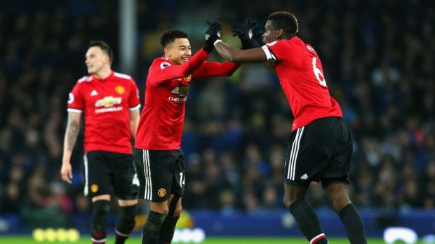 Jesse Lingard celebrates with Paul Pogba after scoring United's second