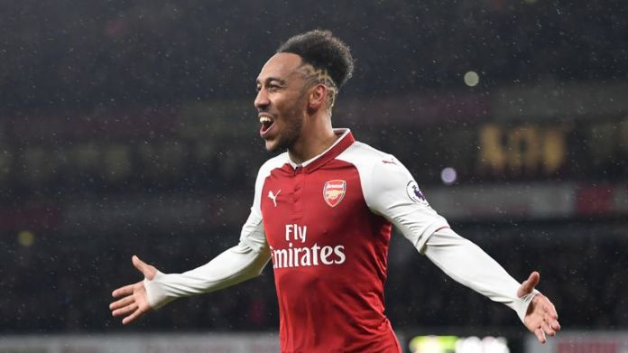 Pierre-Emerick Aubameyang celebrates after scoring on his debut for Arsenal