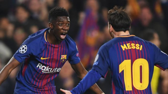 Ousmane Dembele celebrates with Lionel Messi