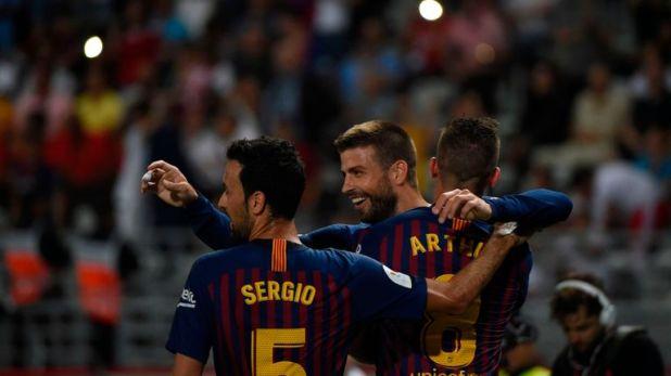 Gerard Pique celebrates after scoring Barcelona's equaliser