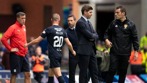 Neil McCann talks with Kenny Miller after Dundee striker was sent off at Ibrox