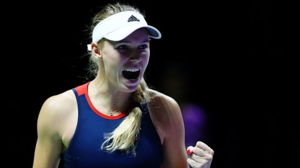 Caroline Wozniacki picked up a much-needed win against Petra Kvitova