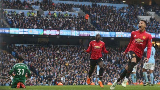 Jesse Lingard celebrates against Manchester City