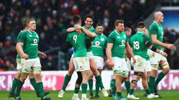 Carbery celebrates Ireland's Grand Slam triumph in Twickenham last March