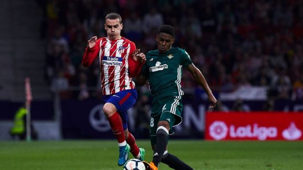 Firpo battles for the ball with Antoine Griezmann