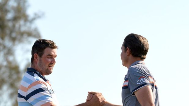 Marc Leishman (L) is Smith's nearest challenger