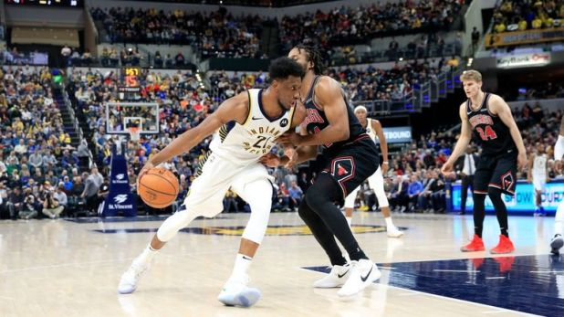 Thaddeus Young of the Indiana Pacers dribbles the ball against the Chicago Bulls