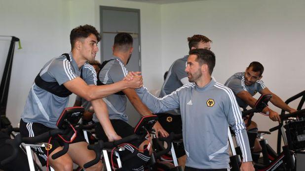 Kilman greets Joao Moutinho at the Wolves training ground