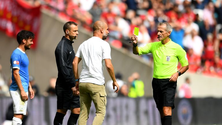 Pep Guardiola is booked for his touchline tirade on fourth official Stuart Attwell