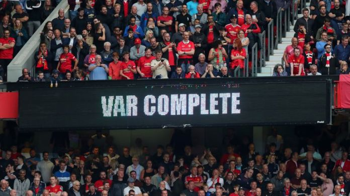 At Old Trafford, the LED scoreboard is used to display information to the crowd on the status of a VAR check