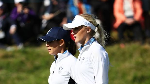 Charley Hull and Azahara Munoz let slip a commanding lead in the fourballs