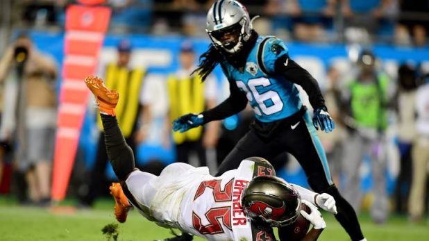 Peyton Barber was chopped down in his own endzone for safety that gave Carolina late hope of a win