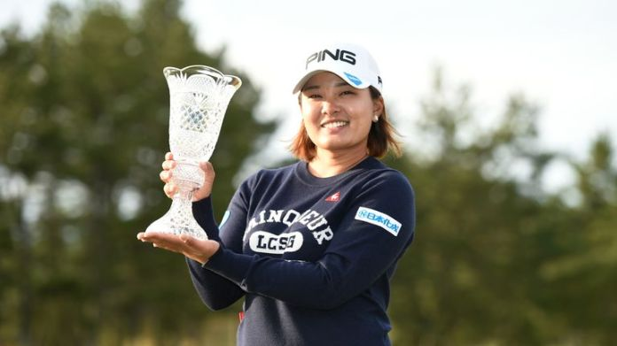 Ai Suzuki proudly displays her trophy after winning the Japan Classic
