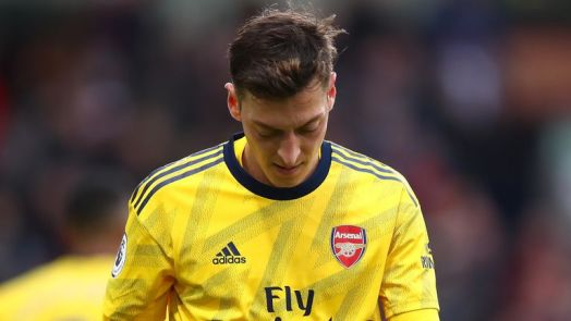 Ozil earns a reported £350,000 a week at Arsenal