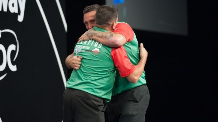Gerwyn Price and Jonny Clayton celebrate kicking off their campaign in style