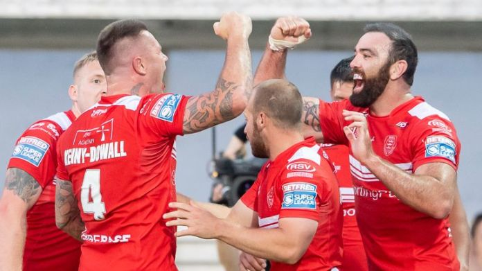Hull KR's Shaun Kenny-Dowall celebrates scoring his try against Salford