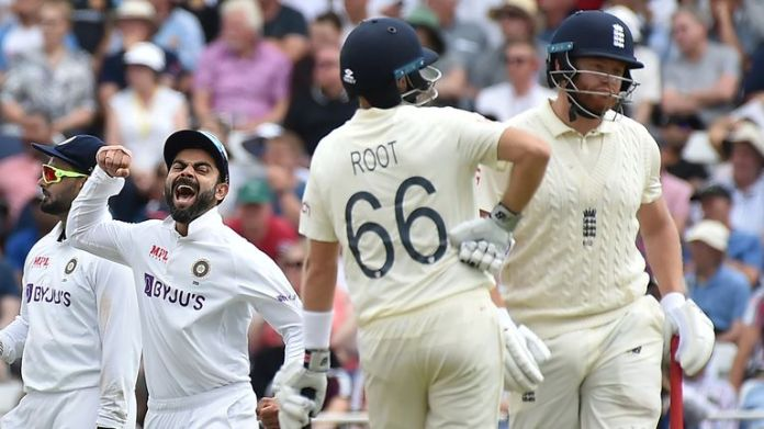 India's Virat Kohli celebrates the dismissal of England's Johnny Bairstow during first day of the first Test between England and India, at Trent Bridge