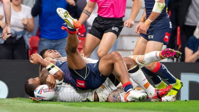Kevin Naiqama squeezes the ball down for his first try