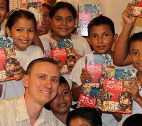 Giving out Bibles to school children in Guatemala