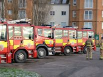 Fire tenders and crew from across Essex wait just outside Jaywick