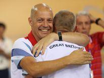 Sir Dave Brailsford hugs coach Shane Sutton at the 2012 London Olympics