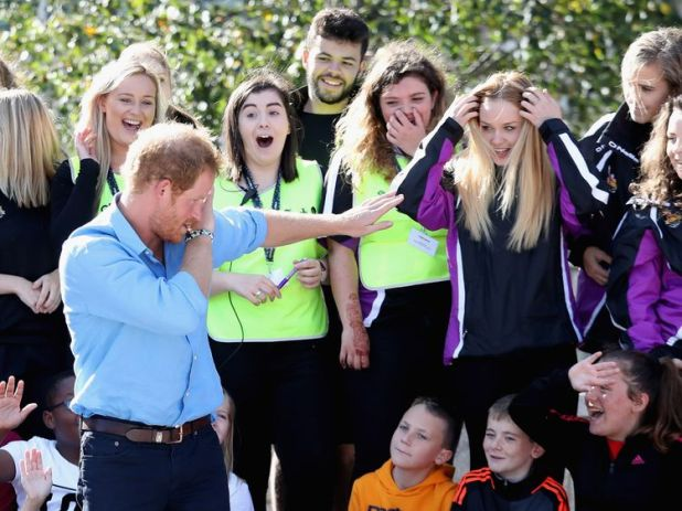 Prince Harry dabbing while visiting a school in Scotland last year