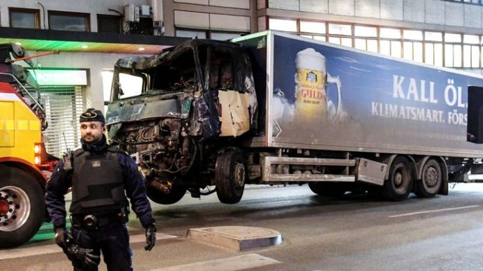 A truck tows away the hijacked lorry which struck pedestrians and crashed into a department store A year of vehicle attacks A year of vehicle attacks e19b7c69f21ad6794c91ccb54a46fca90fb5499c2c8404eb0a440eafc3781c58 3926260