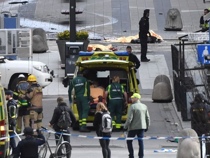 Emergency services at scene Sweden lorry attacker who killed shoppers wanted to build caliphate Sweden lorry attacker who killed shoppers wanted to build caliphate 568d6eadb16de8891f1bfe0b2bea1f4e3f791280df5794ef6849605c6830d3a8 3925861