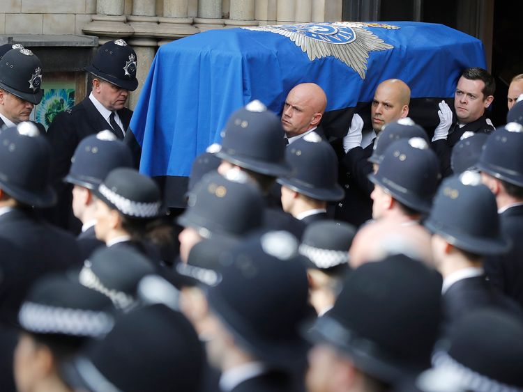 Pallbearer's carry PC Keith Palmer's coffin out of Southwark Cathedral following his funeral