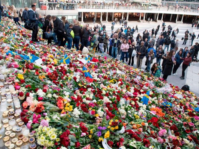 Flowers left on the steps at Sergels Torg plaza in Stockholm close to the point where a truck drove into a department store Sweden lorry attacker who killed shoppers wanted to build caliphate Sweden lorry attacker who killed shoppers wanted to build caliphate ec73cec6981a6f7105cd30f6edf6052fc87722aa356286c3262741c173b65ecf 3927461