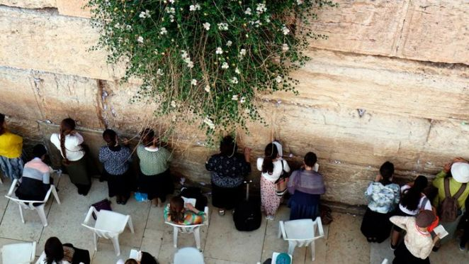 Jewish women pray at the women's section of the Western Wall in the old city of Jerusalem on May 16, 2017.