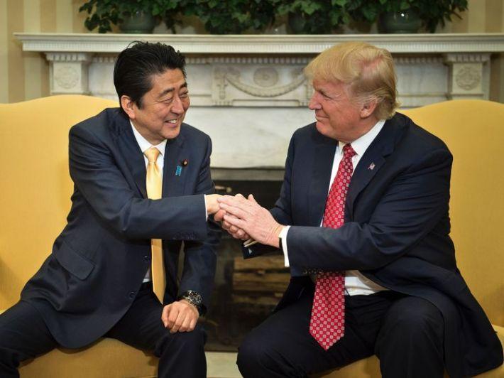 Trump and Abe handshake